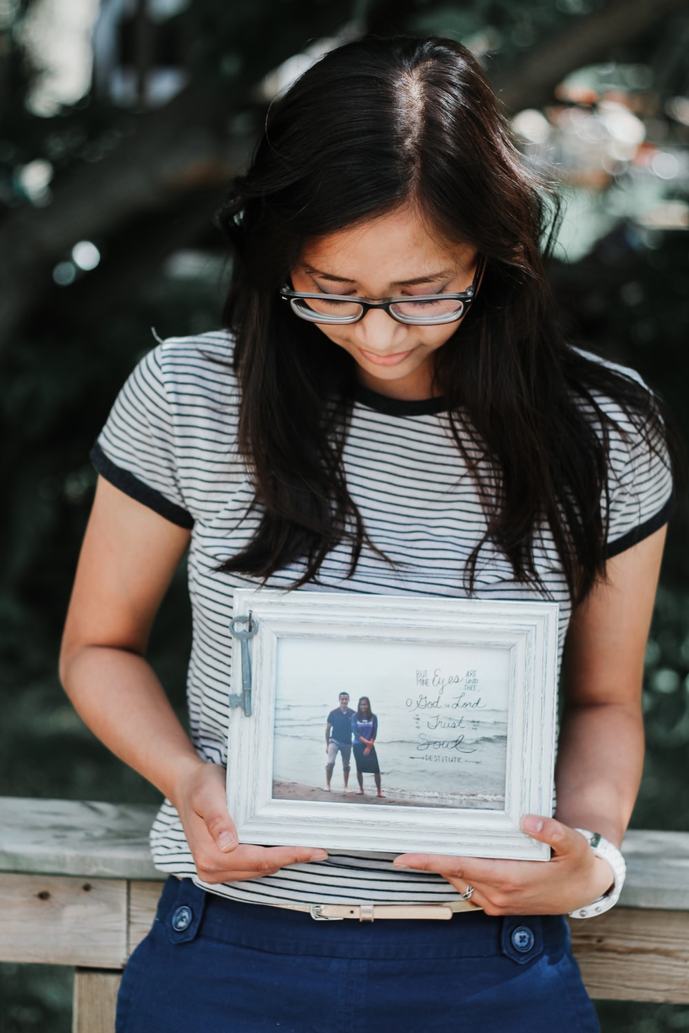 woman holding photo frame