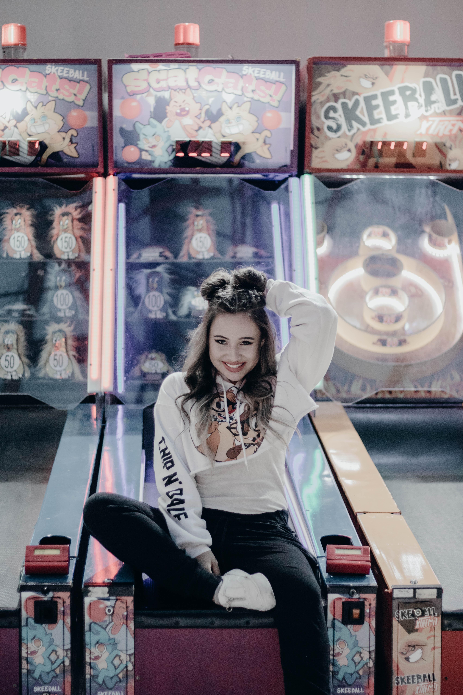 woman sitting in pinball