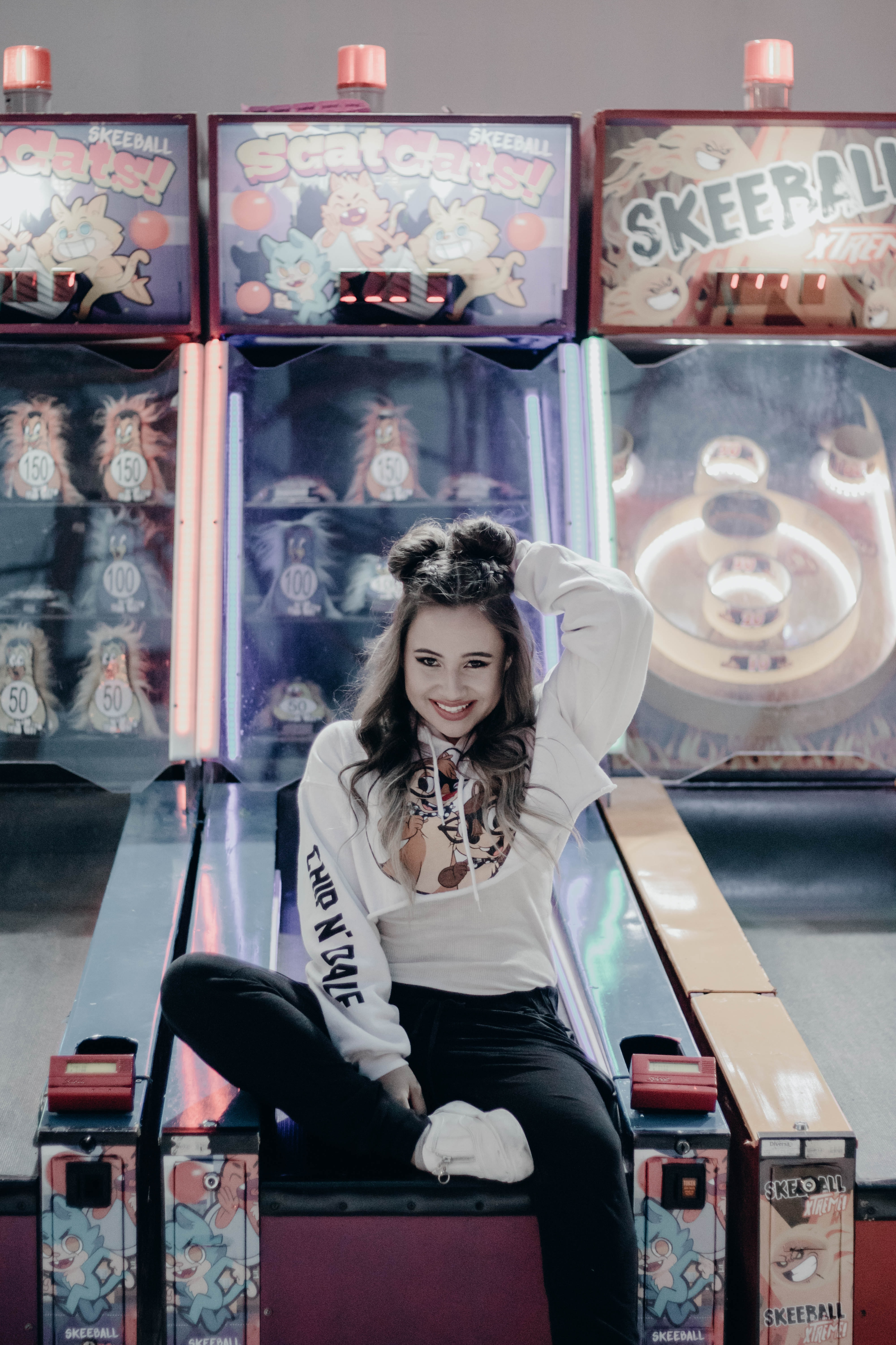 woman sitting in pinball