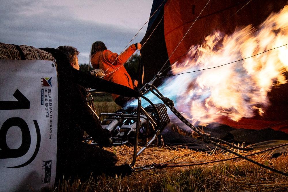 two man preparing hot air balloon