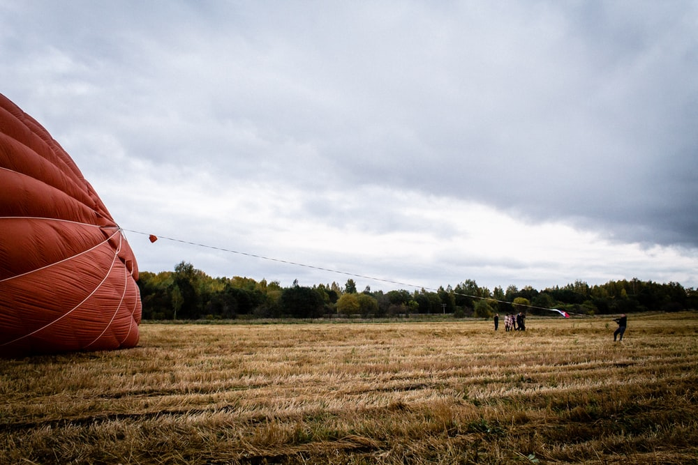 hot air balloon landed on green field