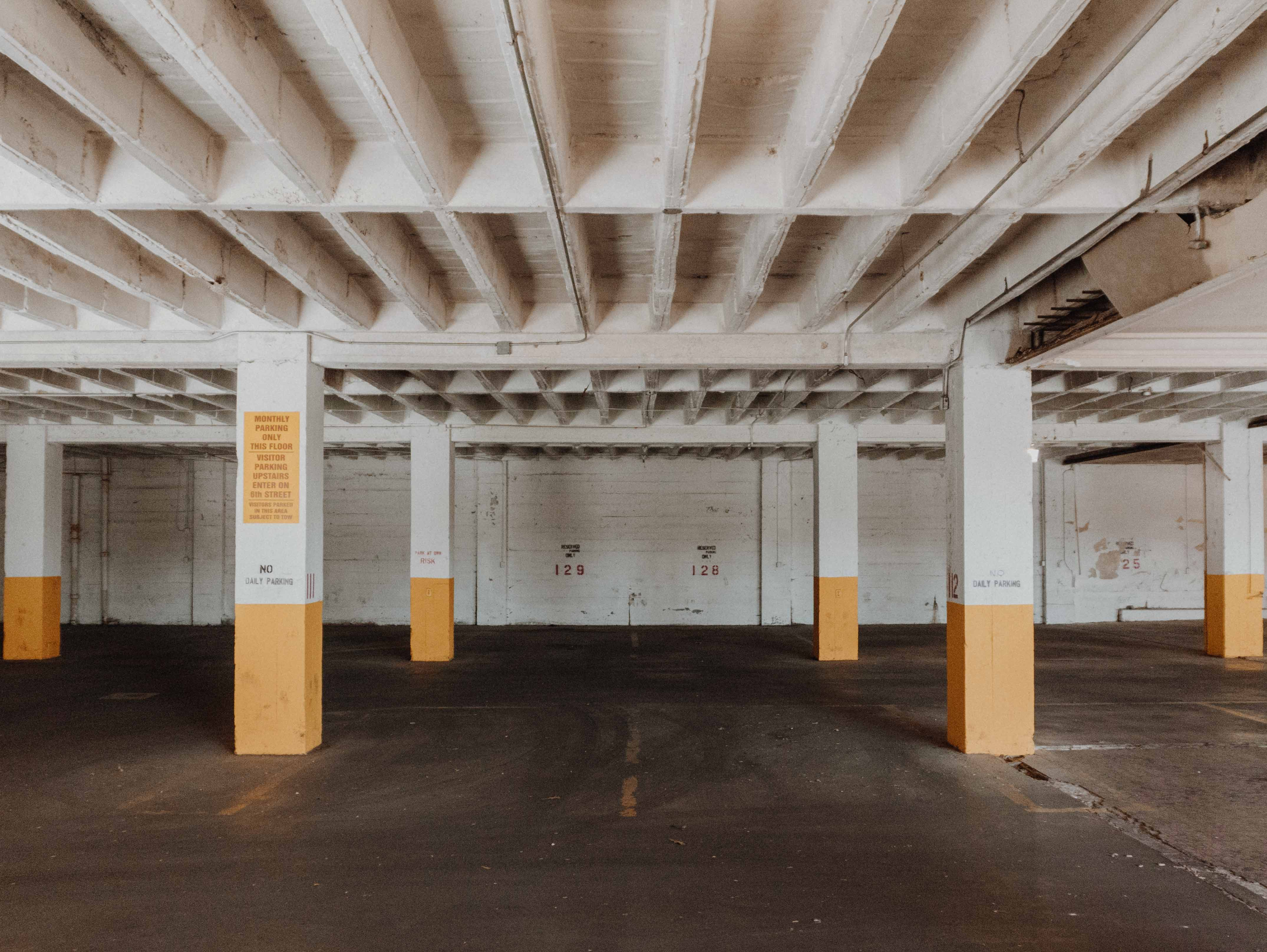white and brown underground parking area