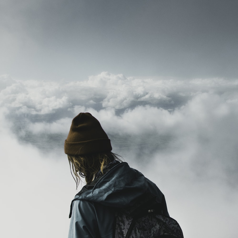 person looking at clouds
