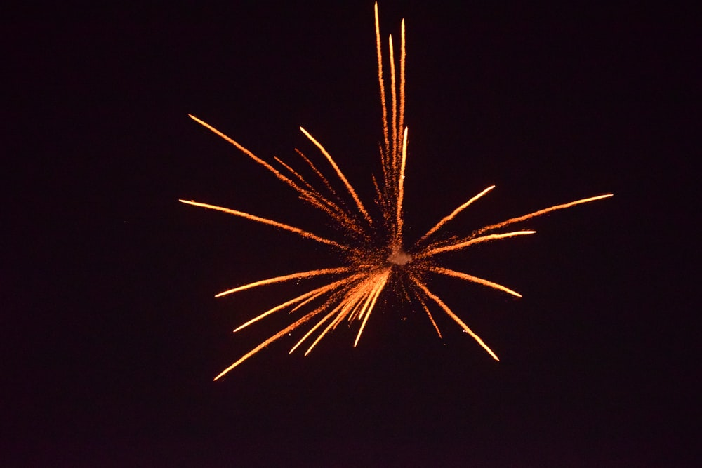 brown fireworks on sky during night time