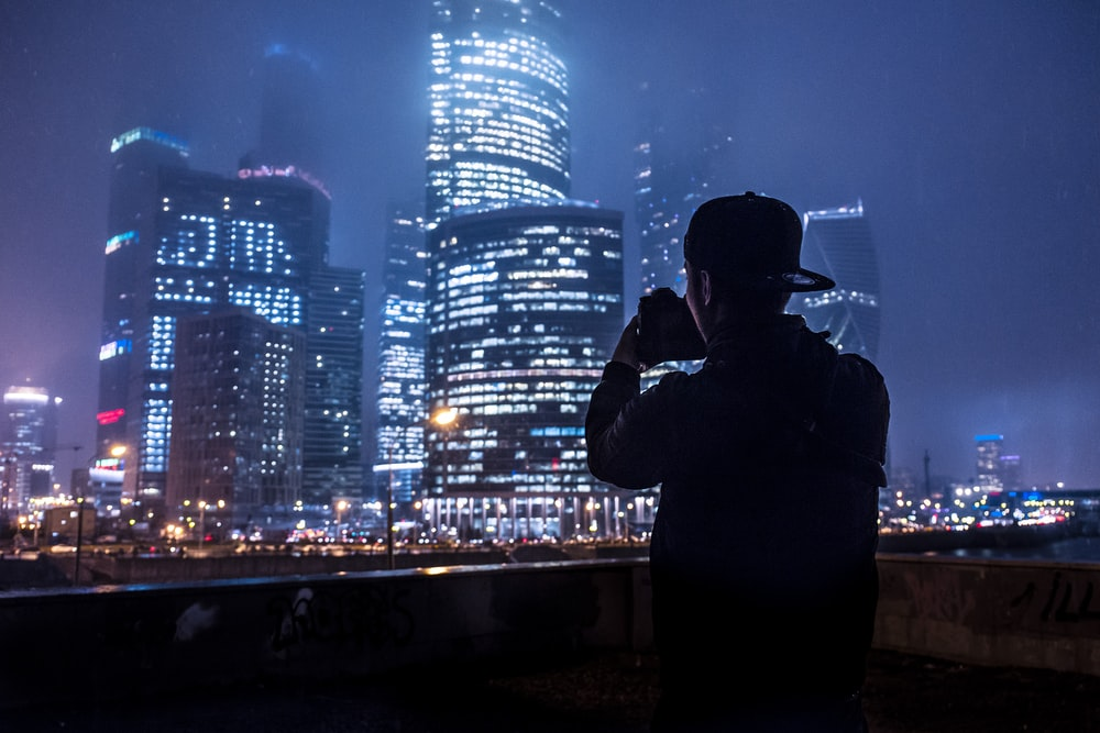man taking a picture of the building