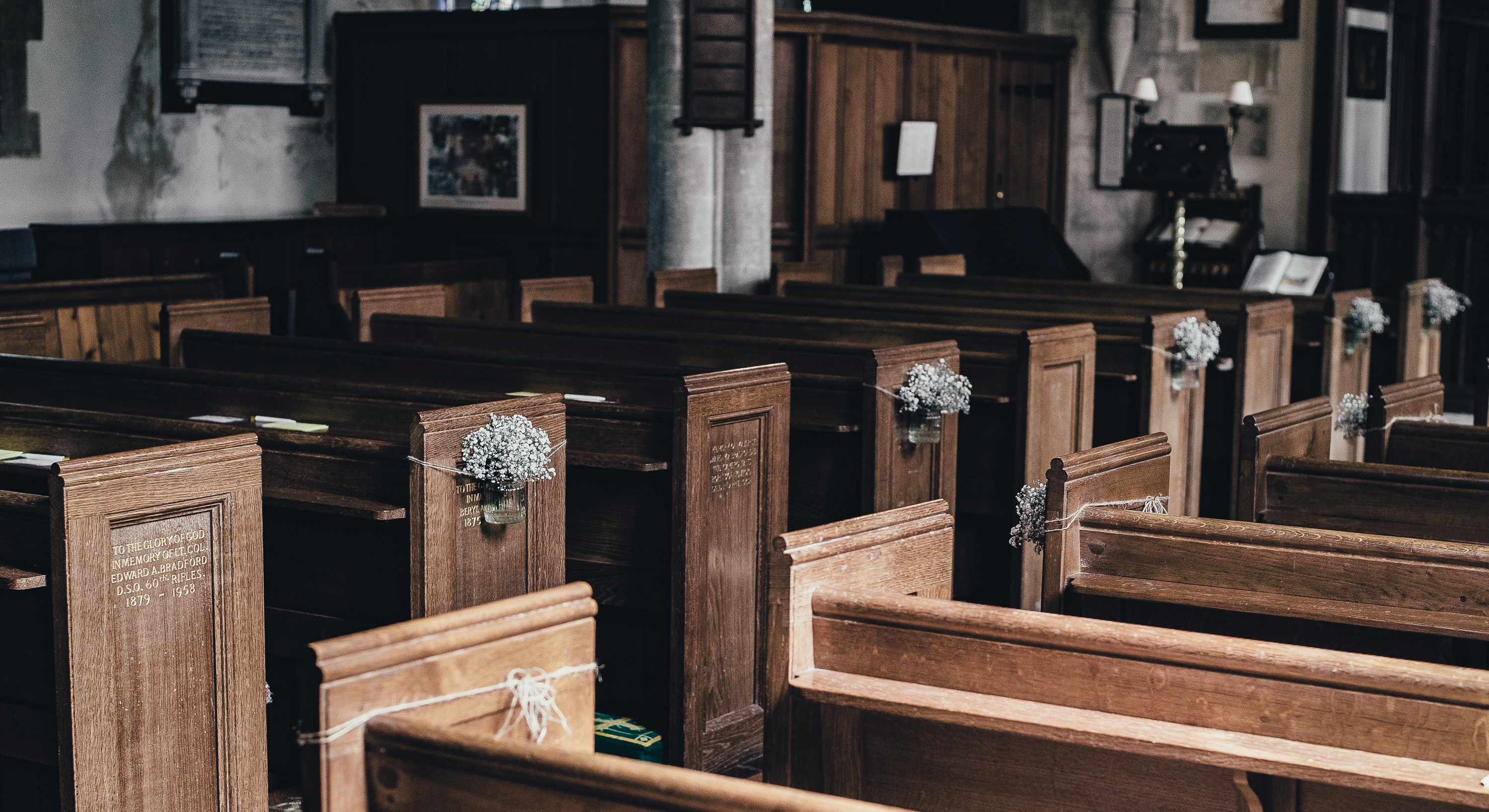 photo of a brown wooden pew lot