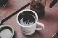 close up photo of white ceramic mug