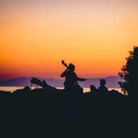 silhouette of person playing musical instrument