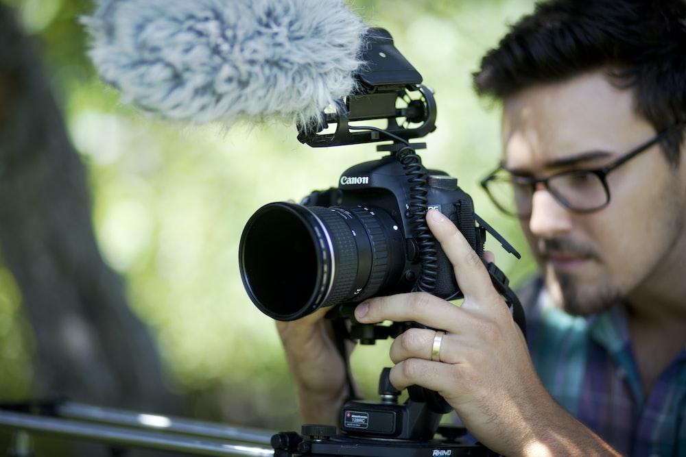 man holding camera slider