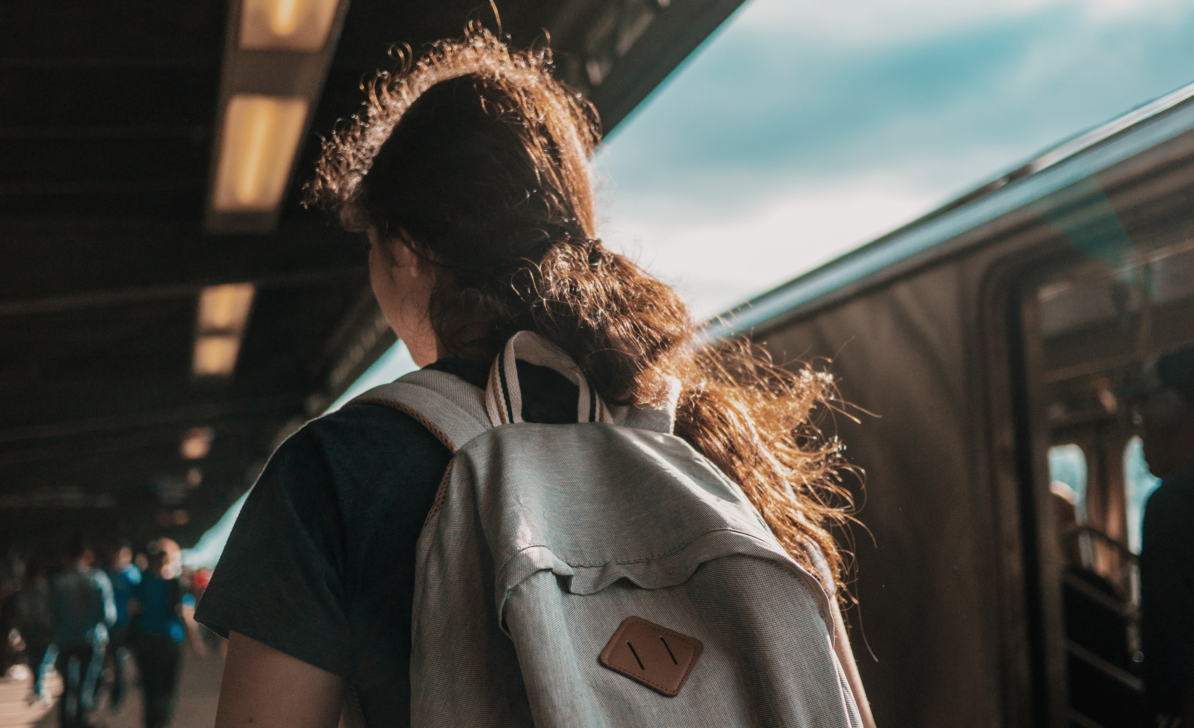 person wearing gray backpack