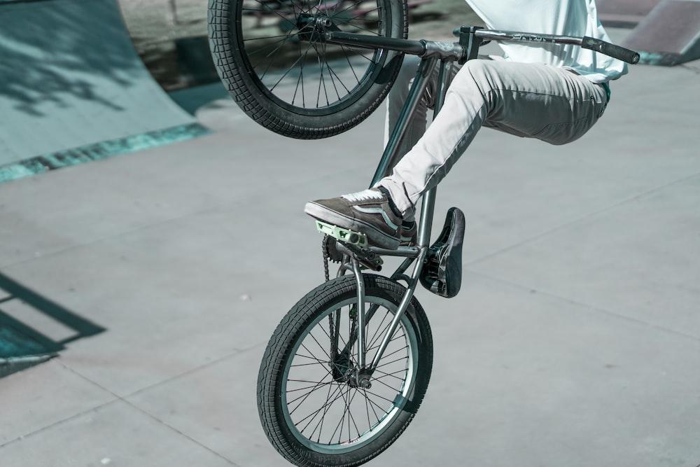 man riding BMX bicycle