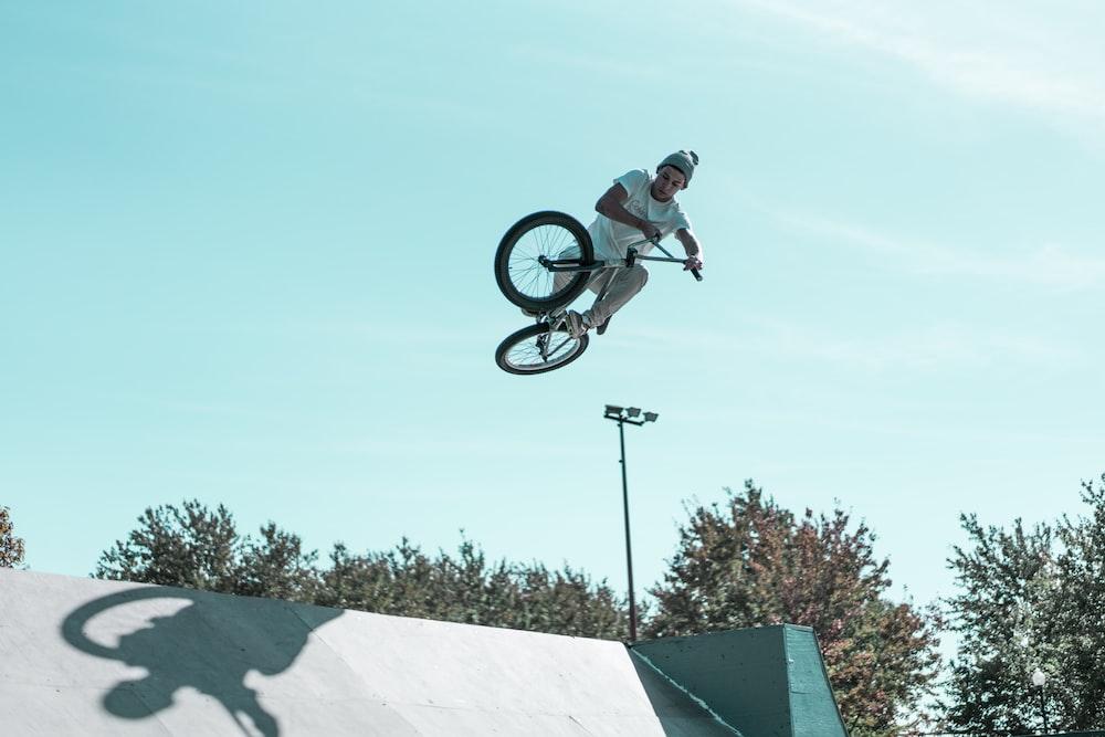 man doing BMX bike stunts