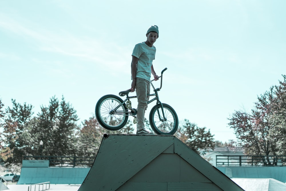 person holding BMX bike