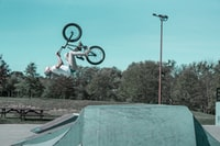 man doing BMX bike stunts