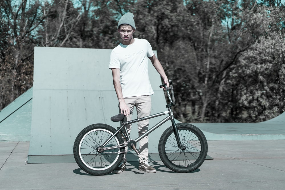 man holding BMX bike