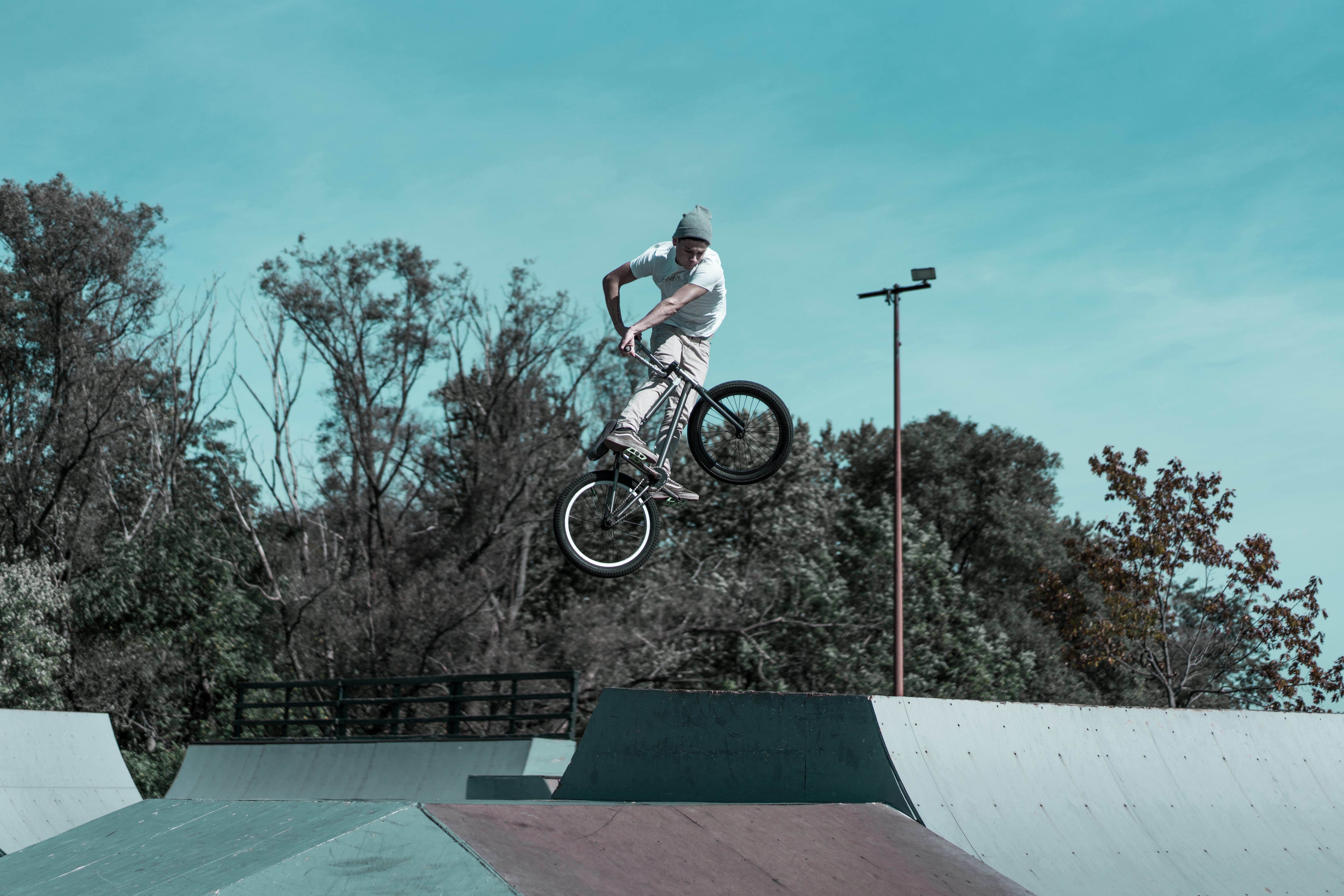 man riding bike performed trick above ramp