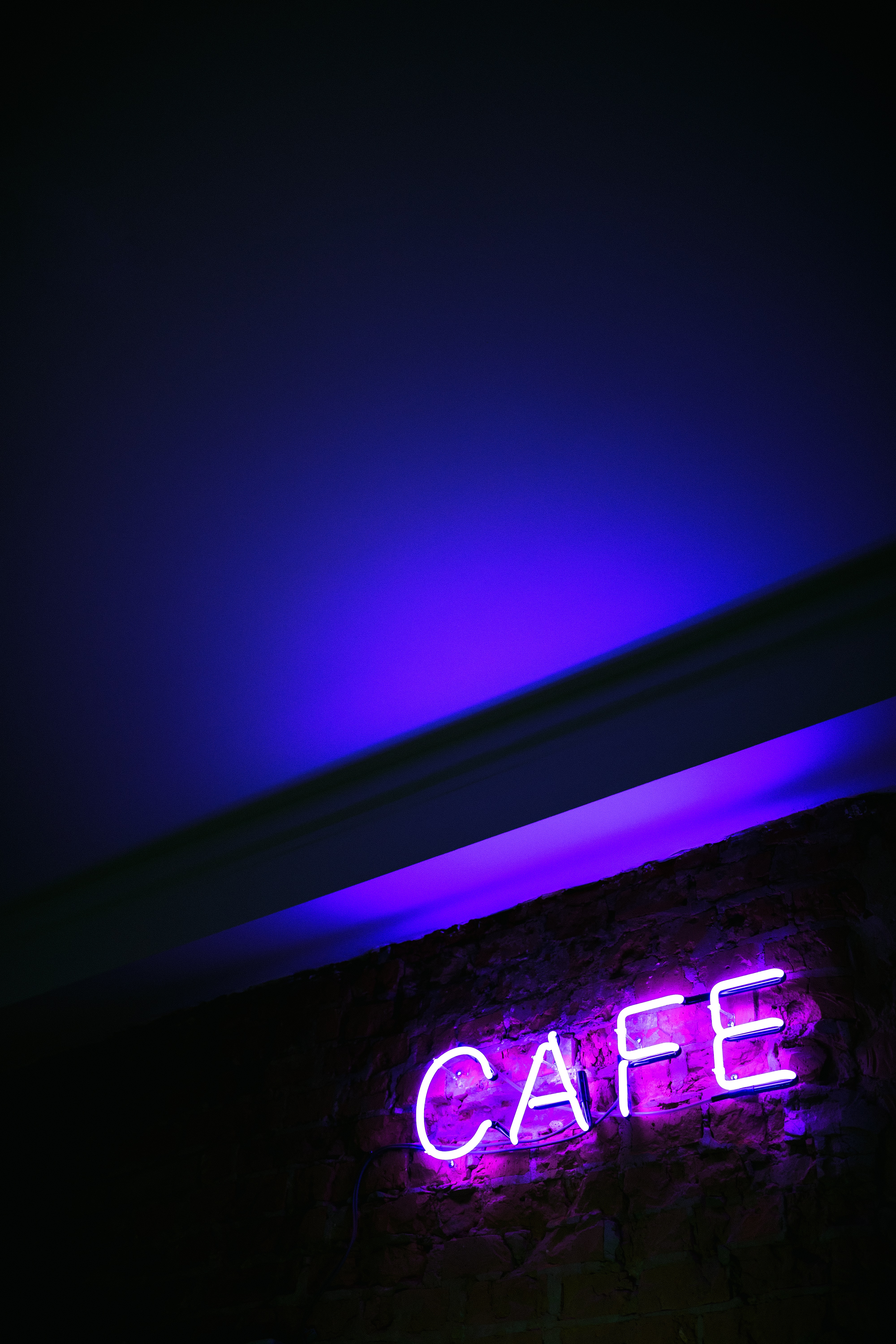 CAFE neon signage mounted on wall