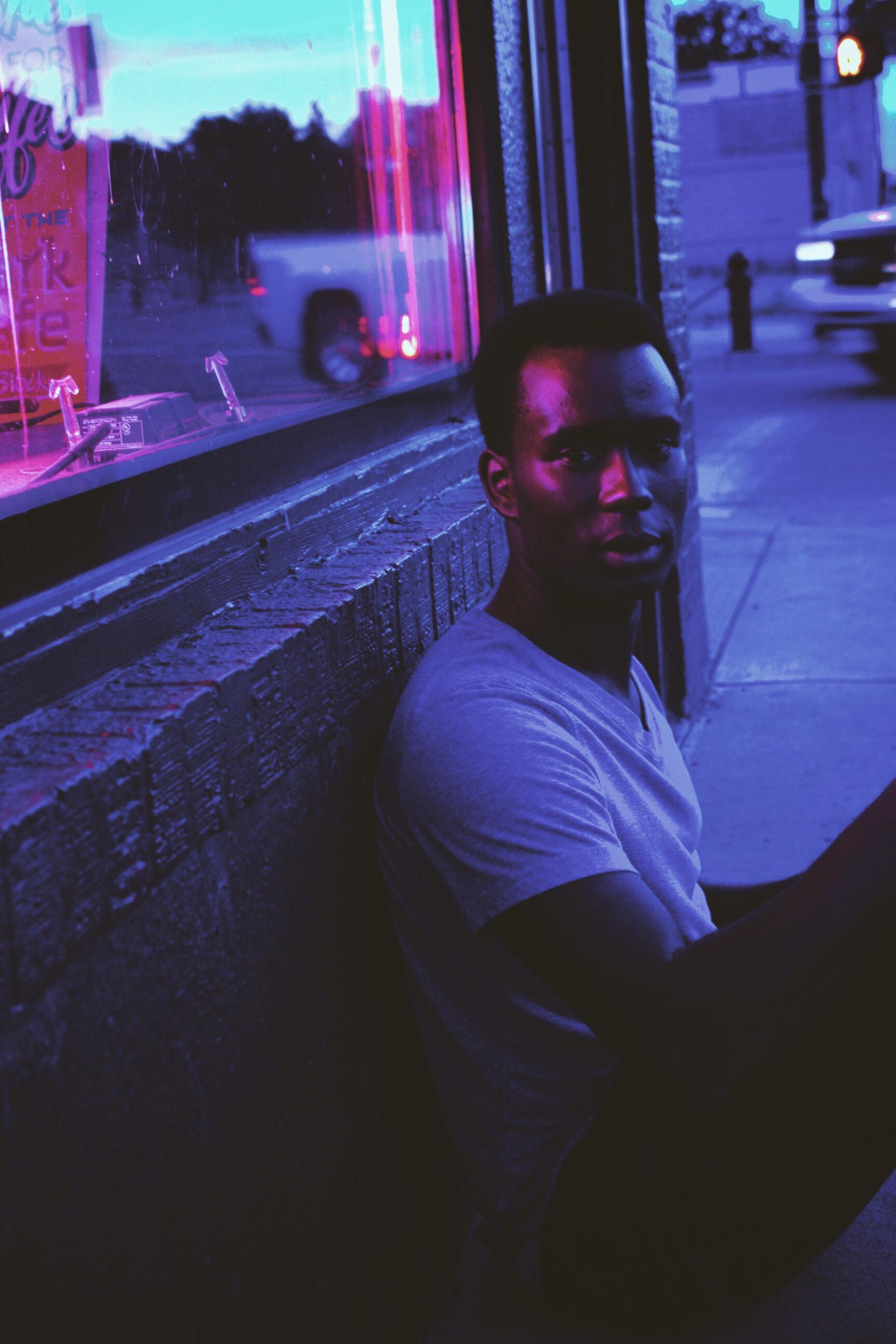 man sitting outside store
