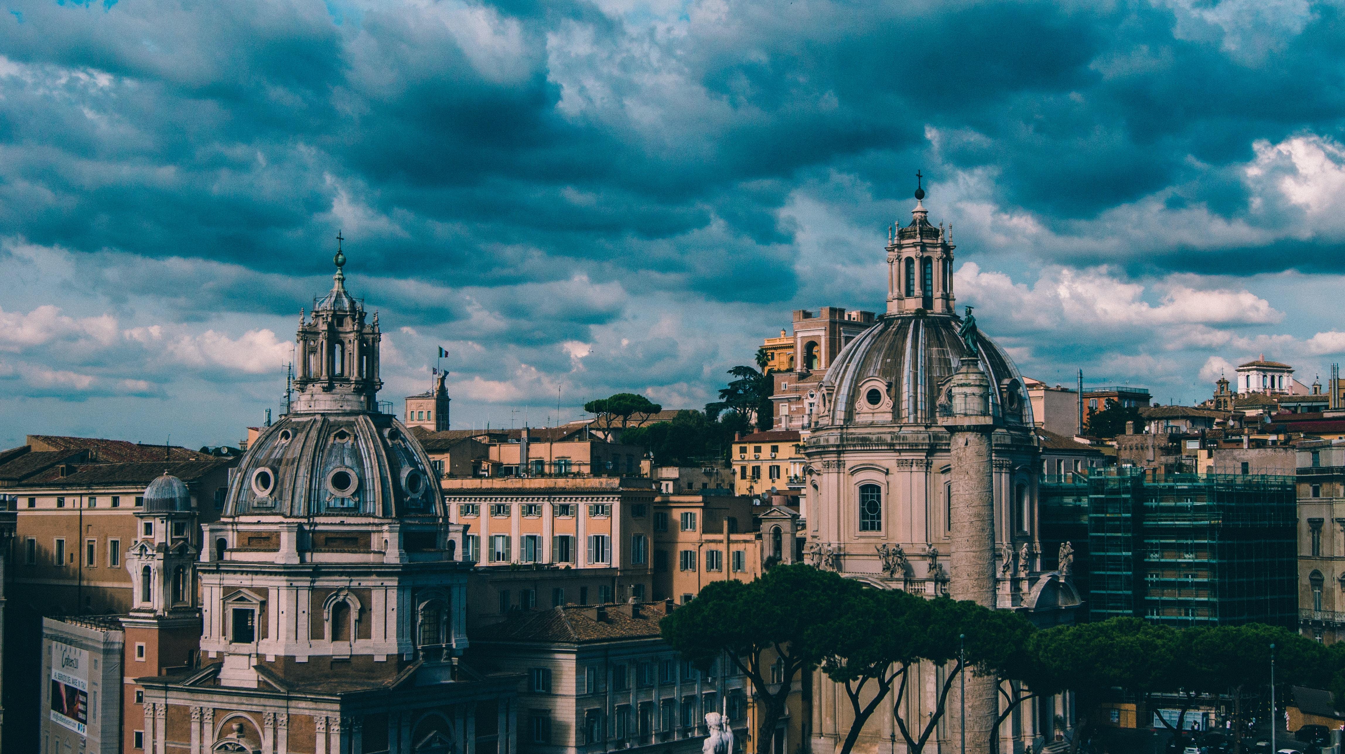 gray concrete buildings under blue cloudy sky
