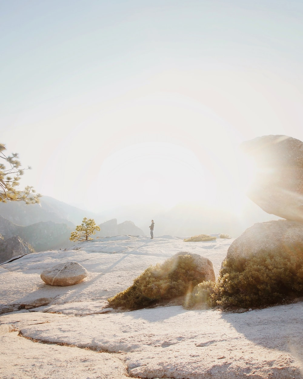 man standing on cliff at sunset