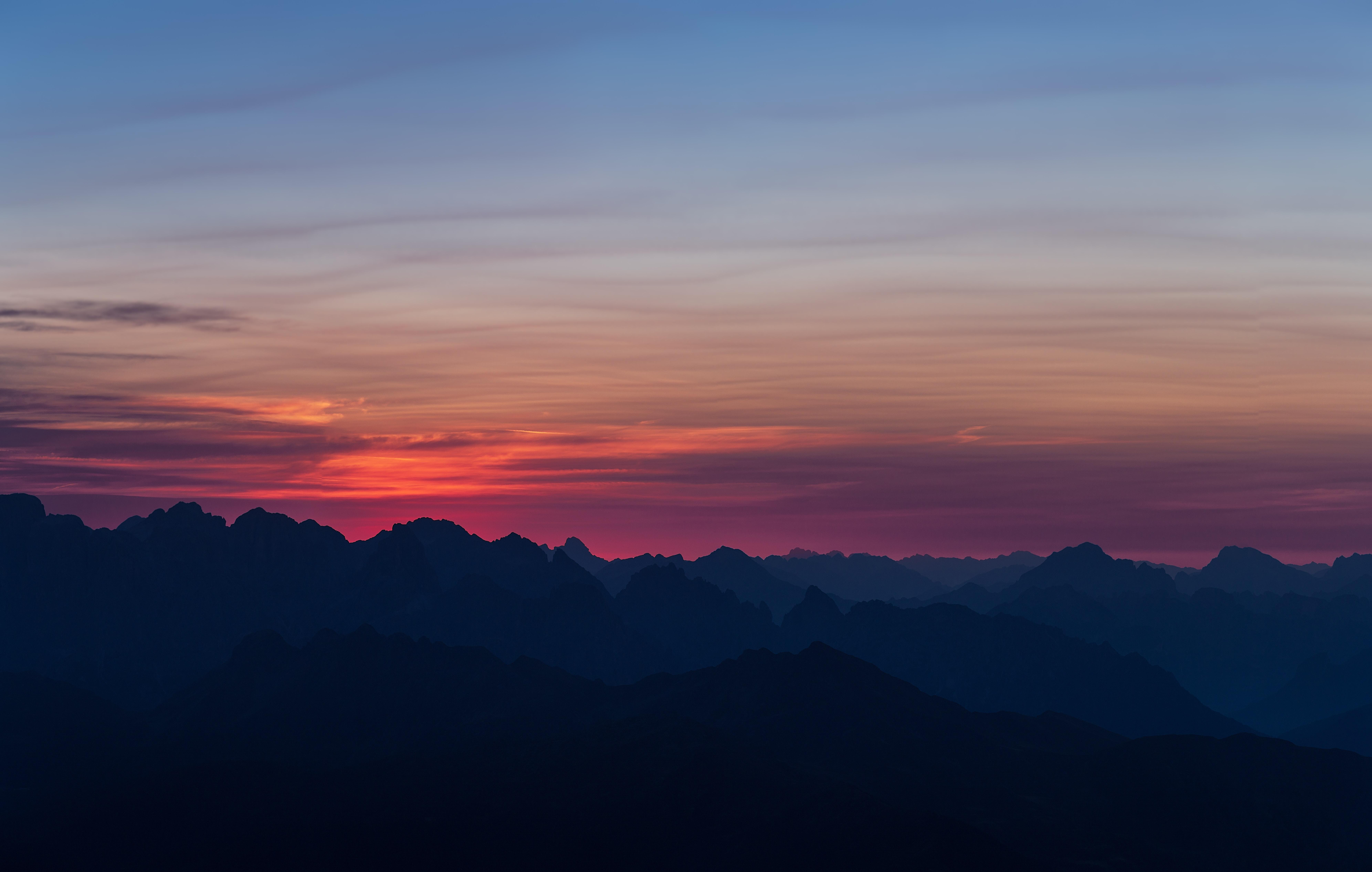 silhouette of mountain on sunset
