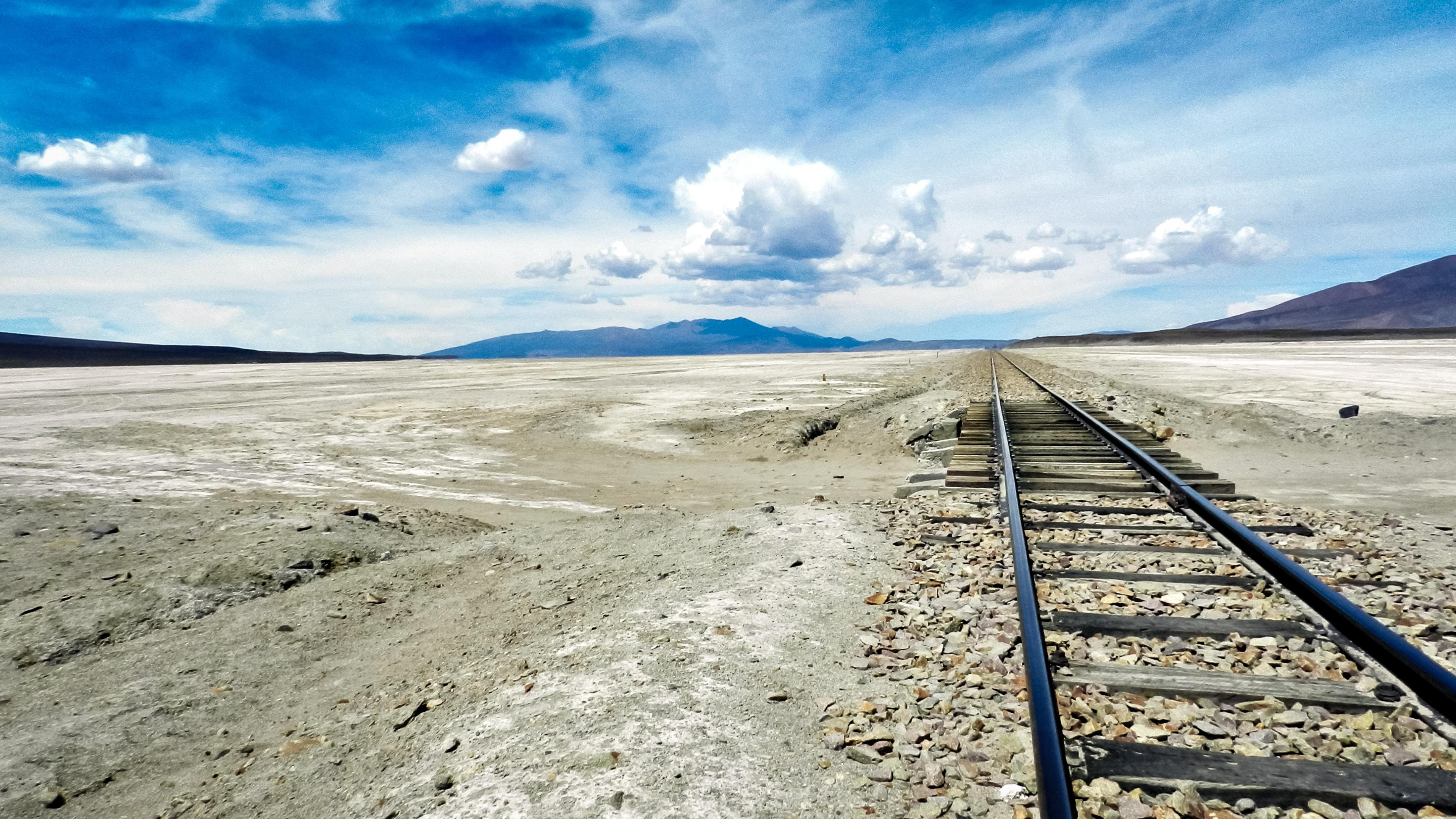black rail road during daytime
