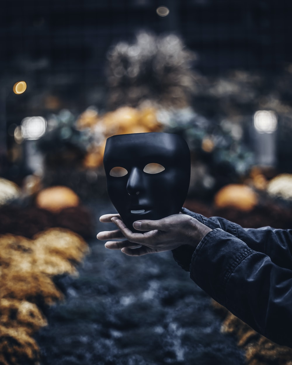 person holding black mask