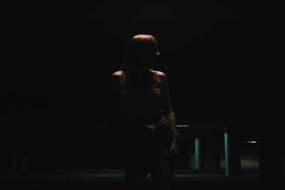 woman standing near empty car park