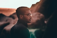 selective focus photo of man looking right side view