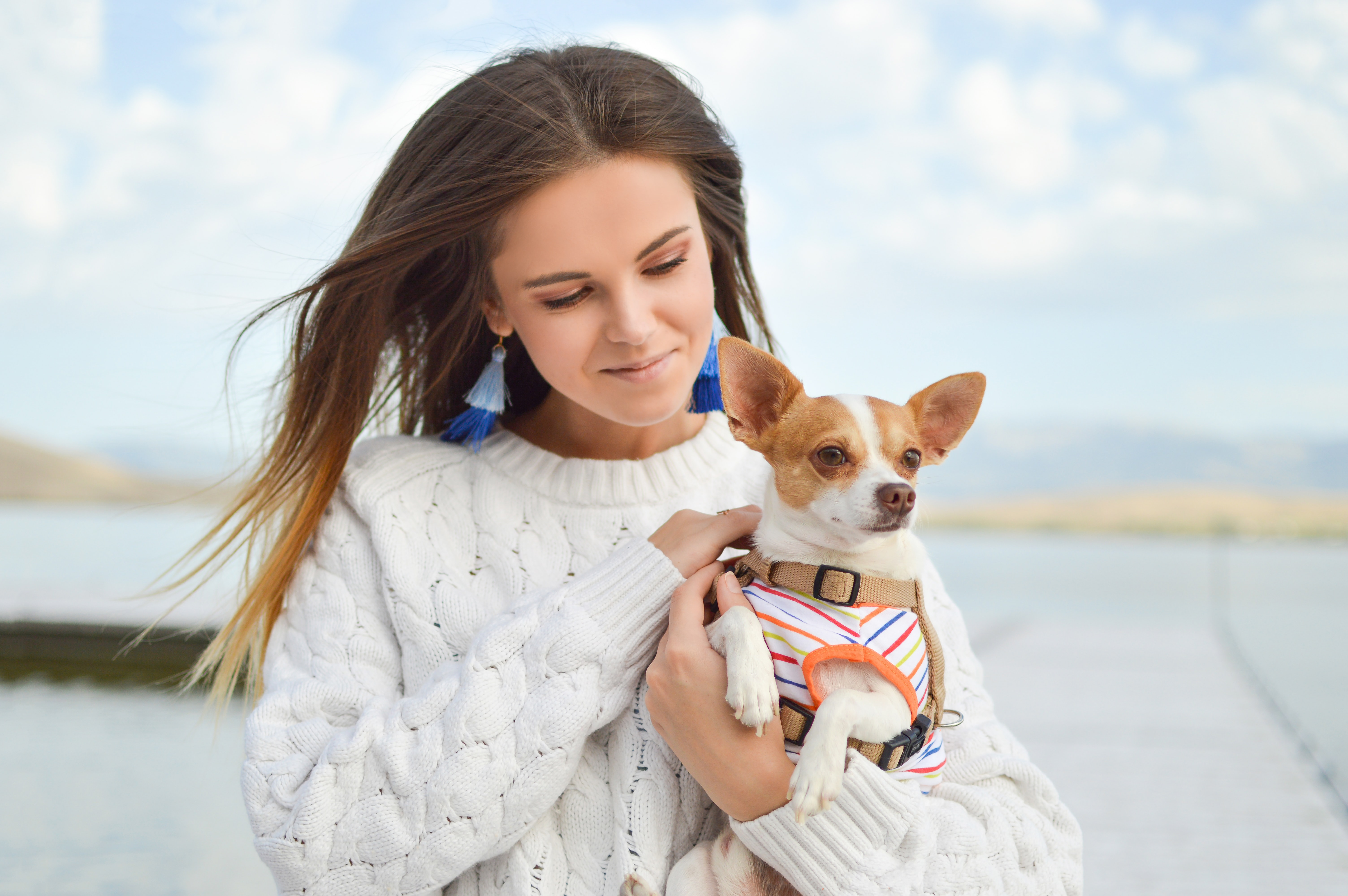 woman carrying dog close up photography