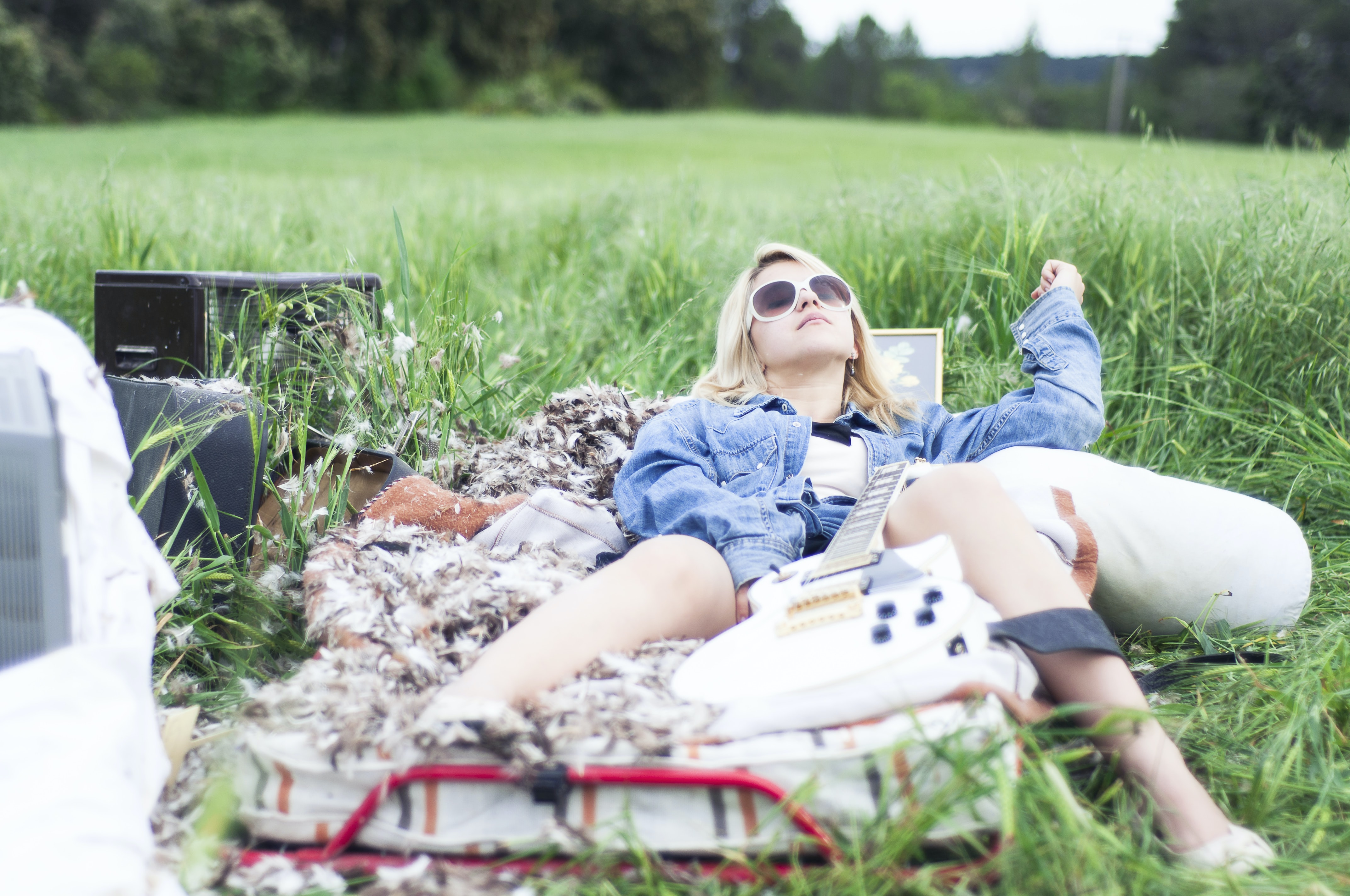 woman laying on bed surround with grass