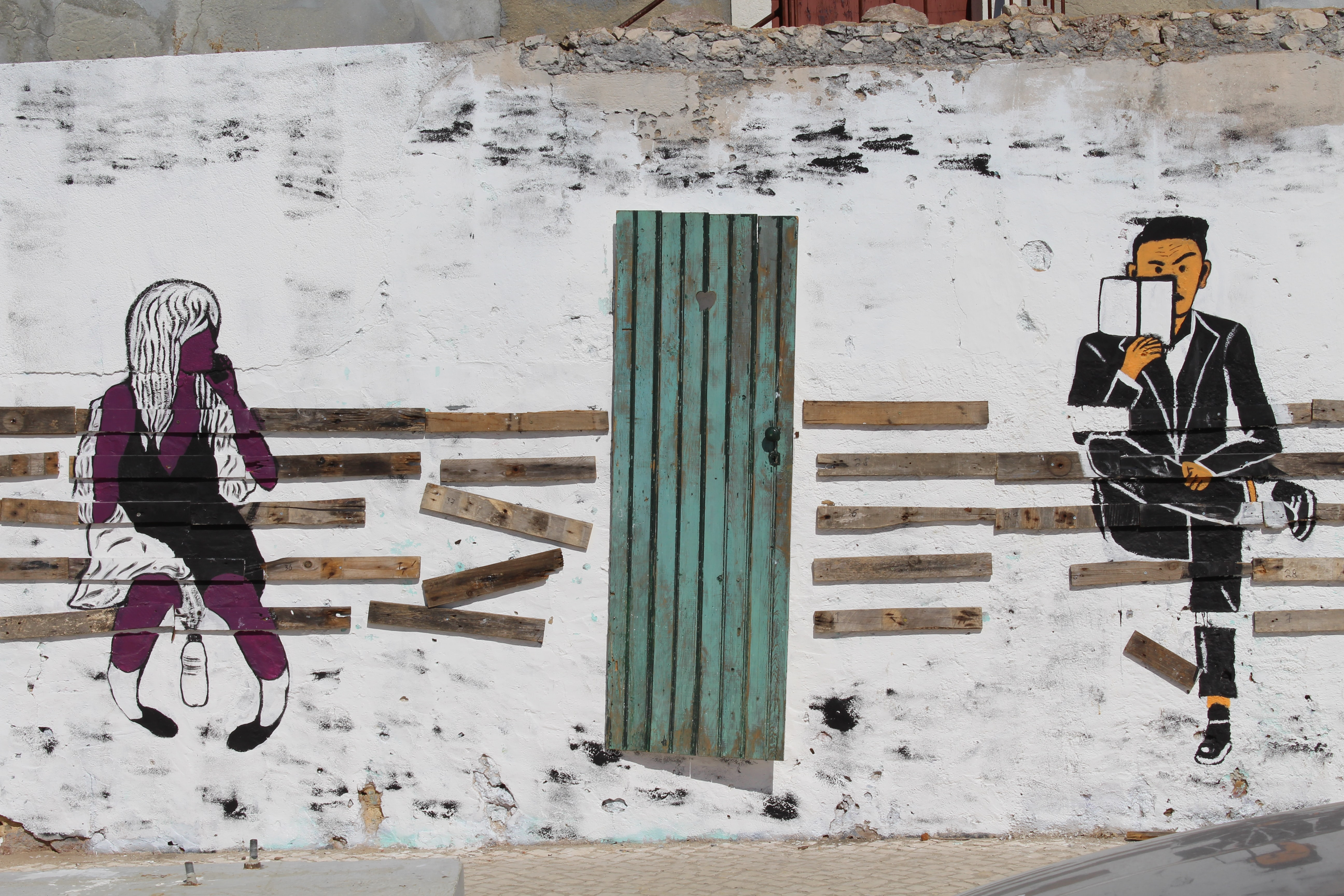 man and woman sitting on bench mural wall art