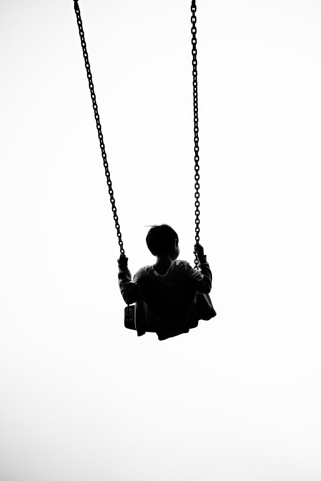 silhoutte of a baby using swing