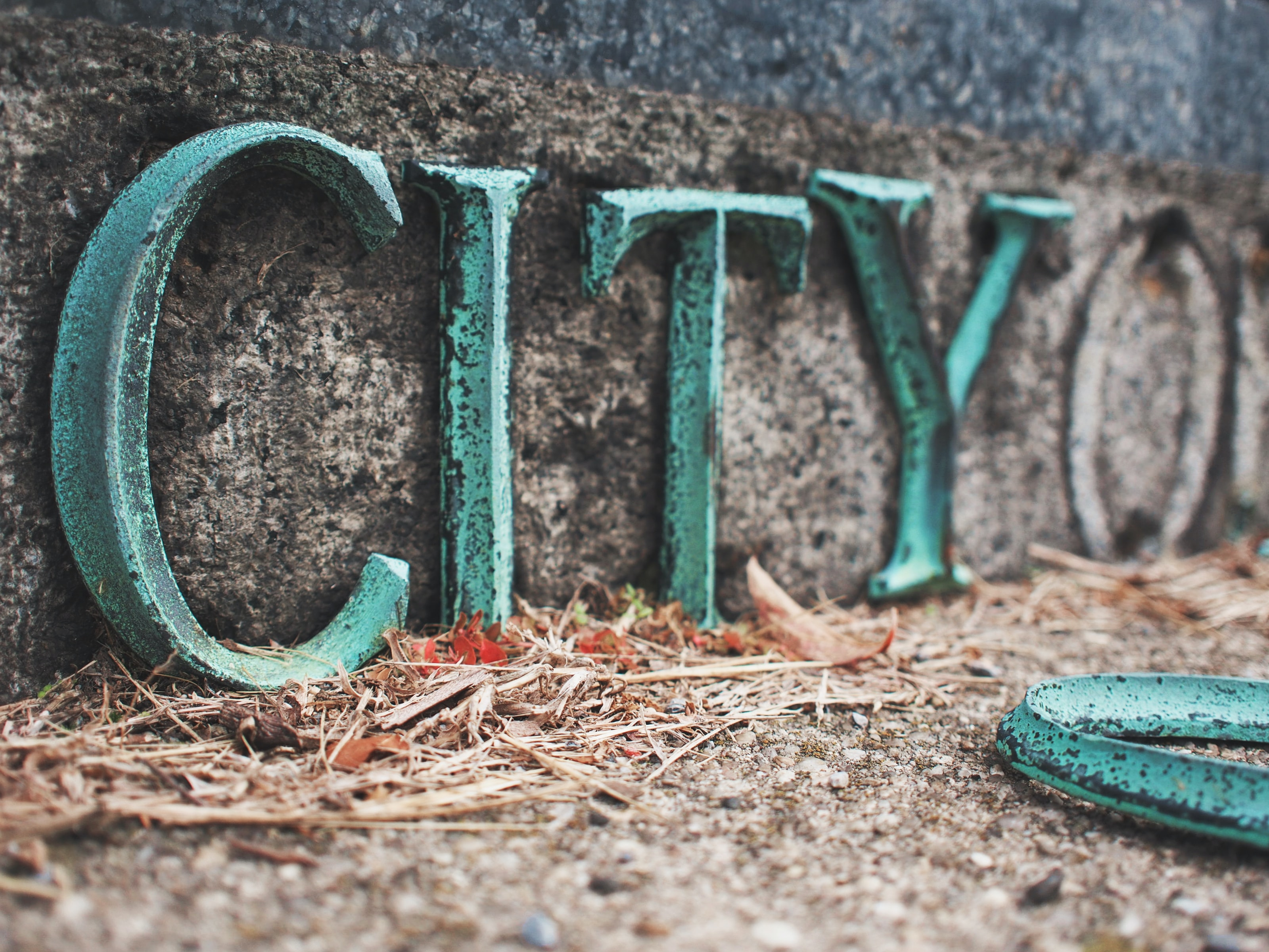 teal and black concrete city freestanding letter decor
