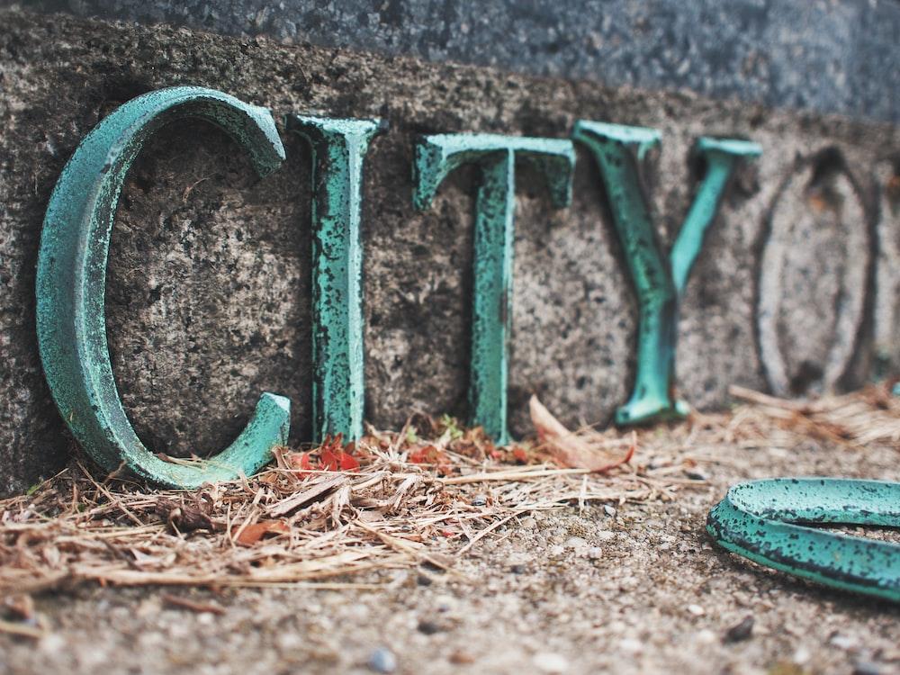 teal and black concrete city freestanding letter decor