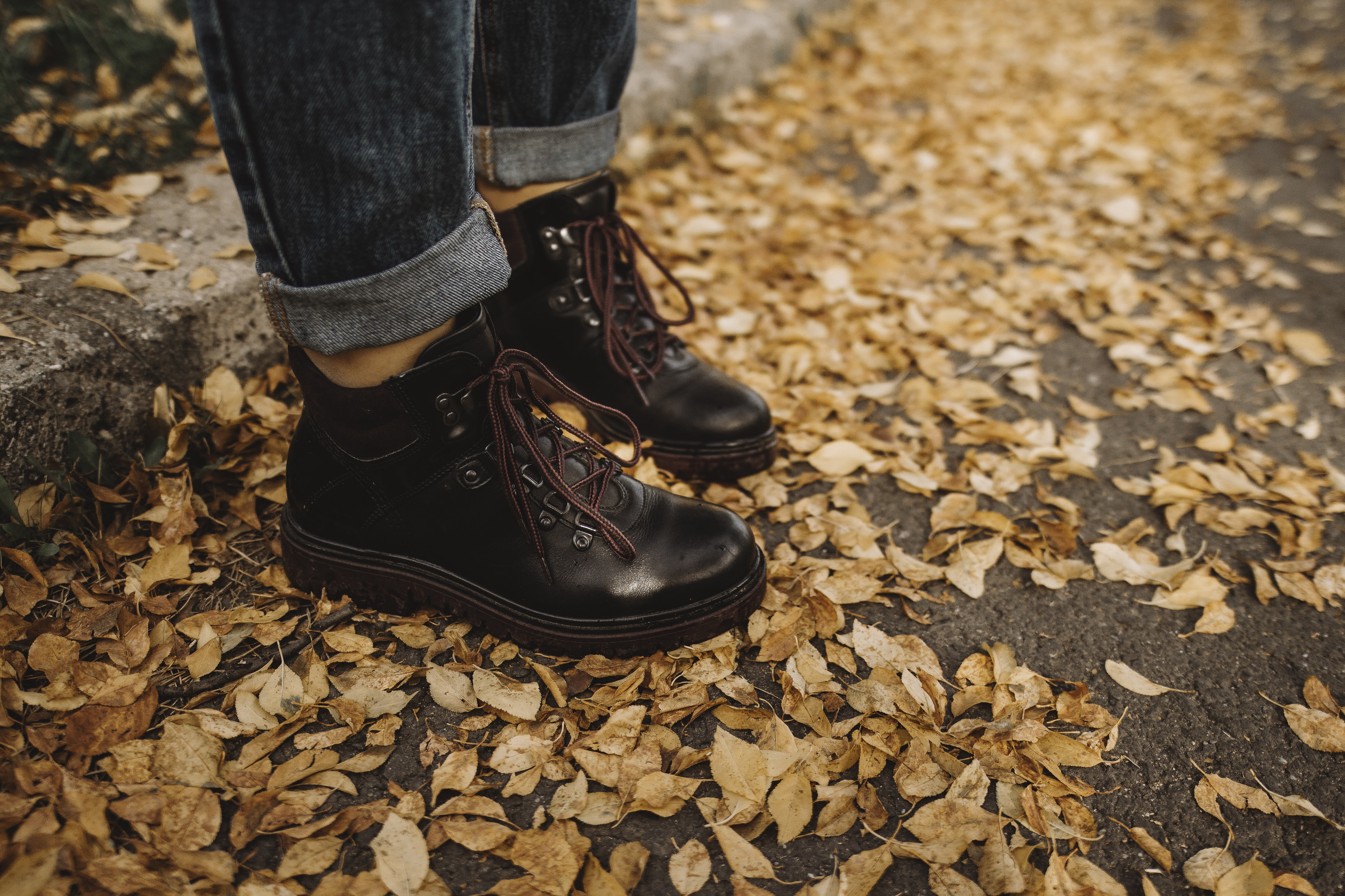 person wearing black leather work boots