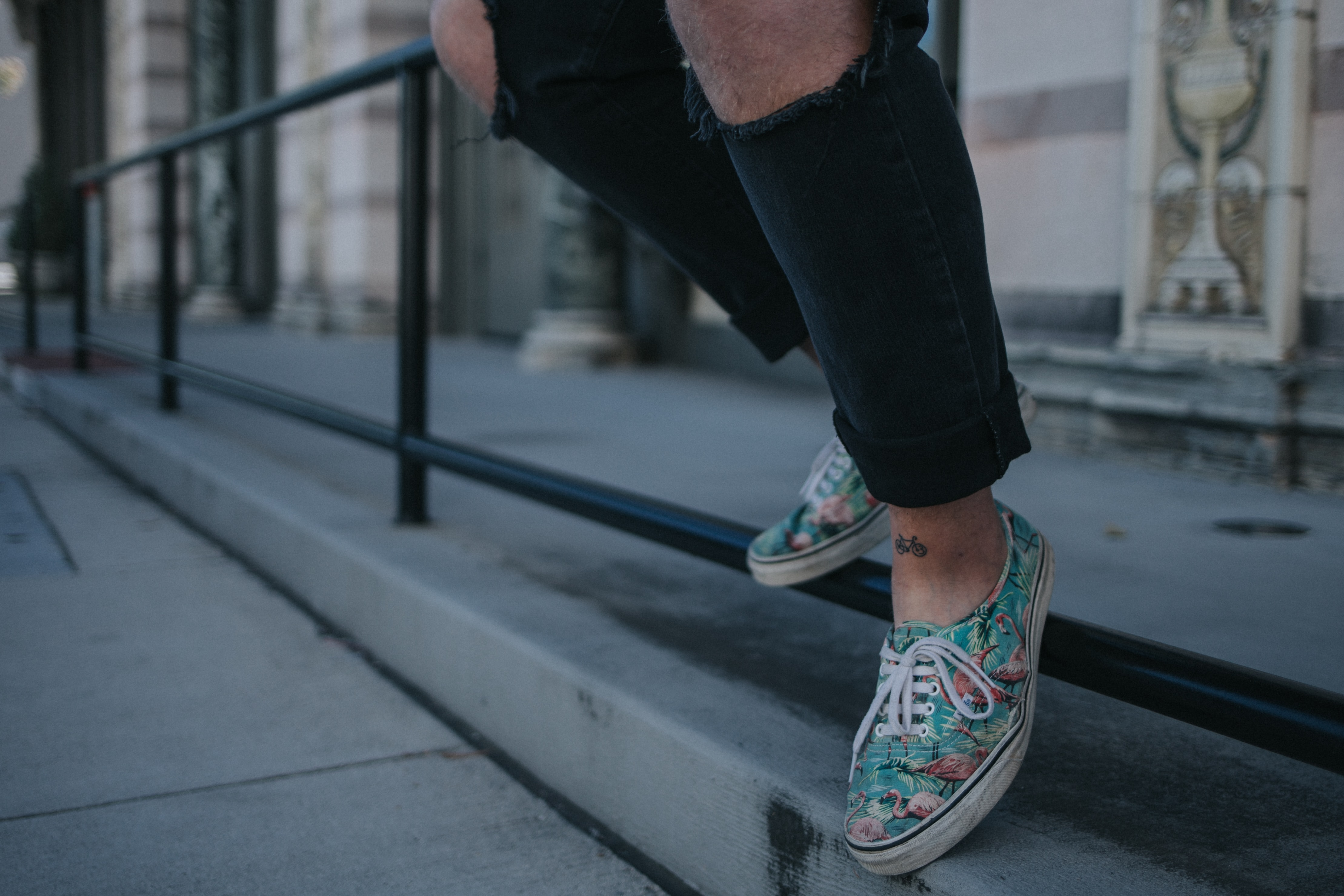 person wearing green-and-white low-top sneakers