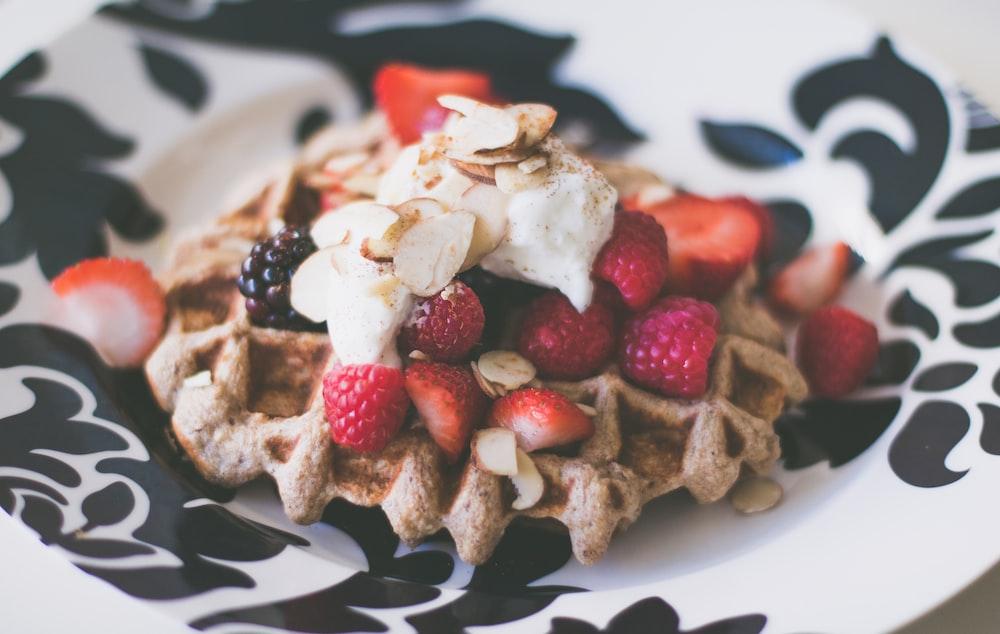 strawberries dessert in white and black ceramic plate