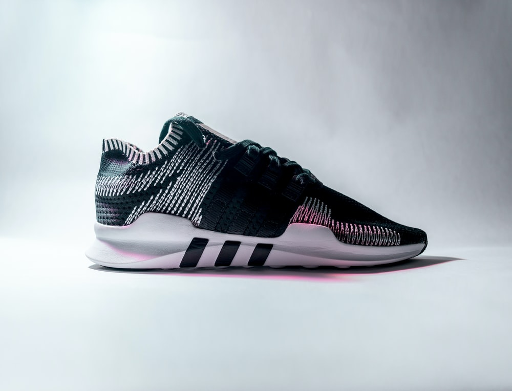 efdd3e7ac689 unpaired black and white Adidas low-top sneaker