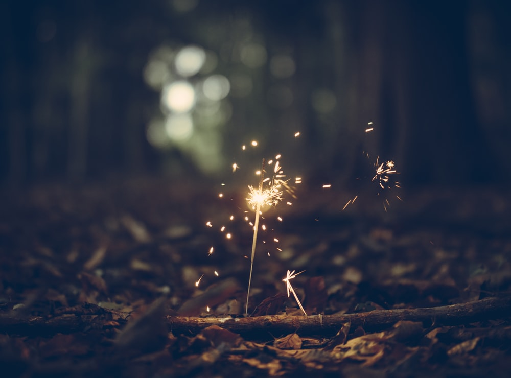 selective focus photography of sparklers