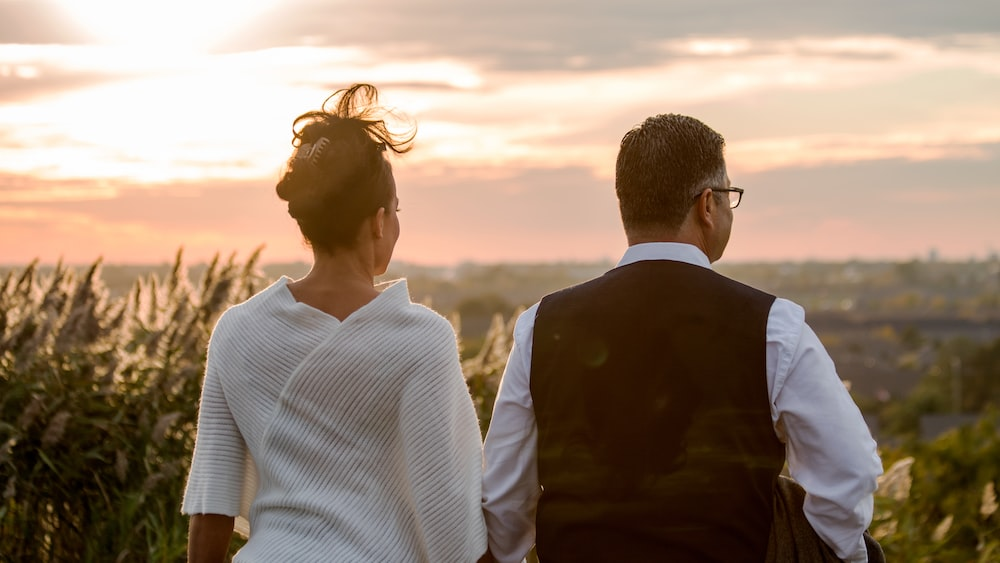man and woman standing outside during daytime