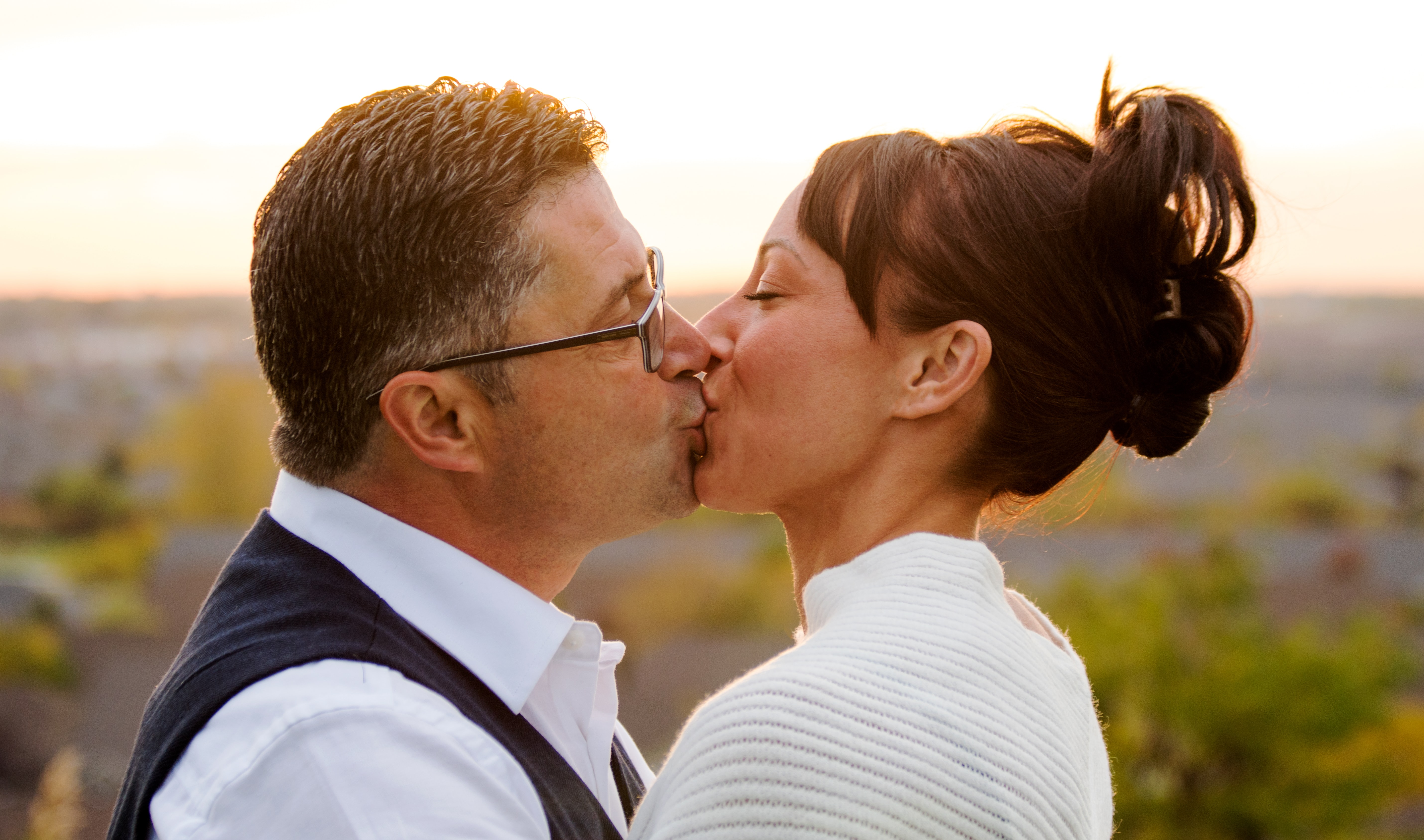 selective focus photo of woman and man kissing each other