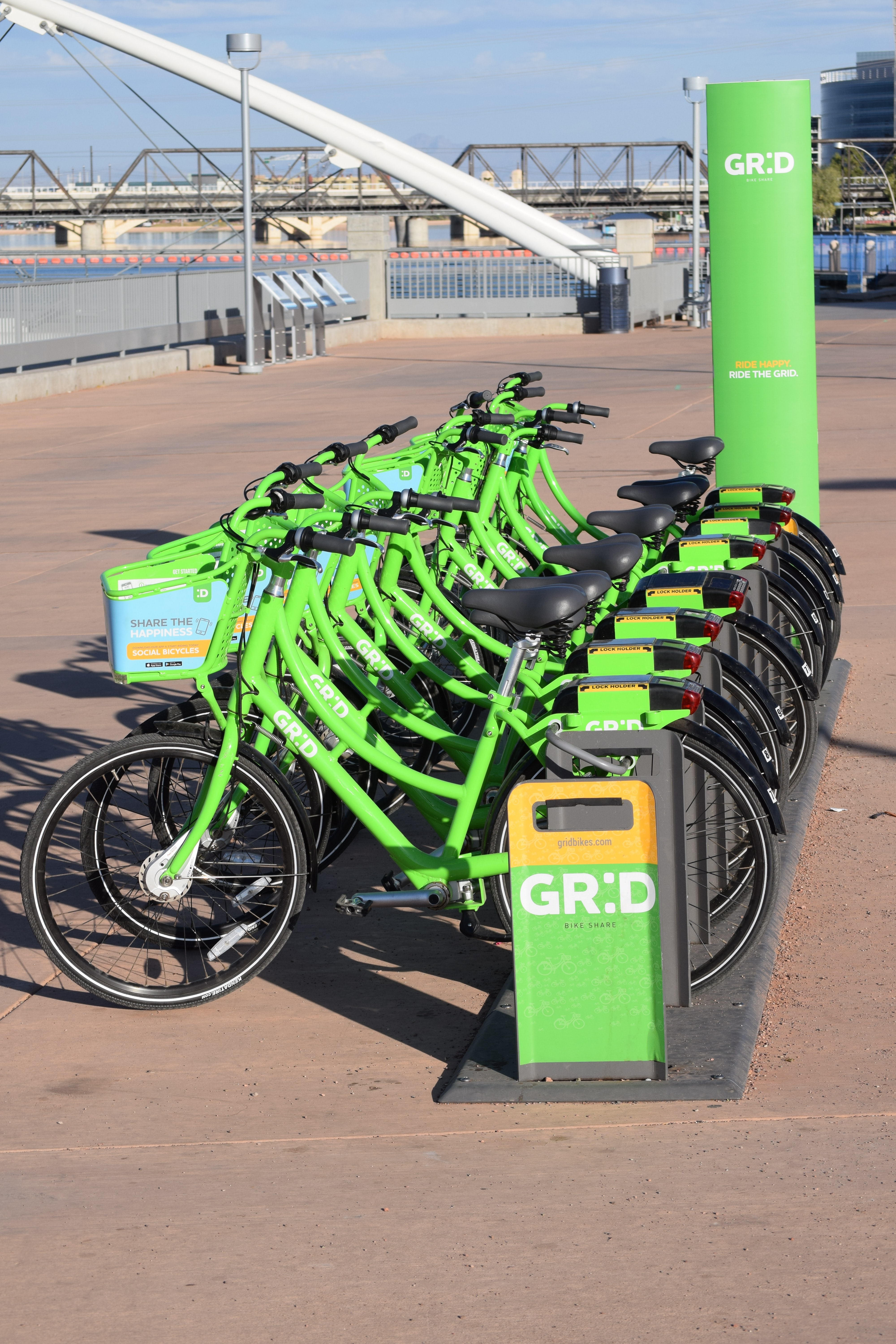 green bicycle parks near GRD post at daytime