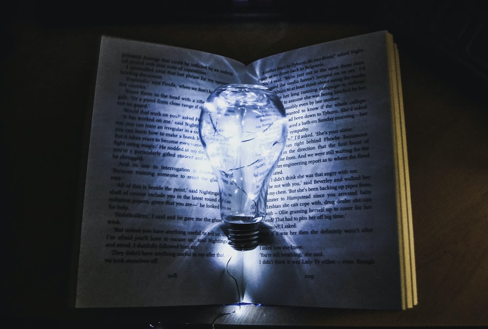 bulb with string lights on book page