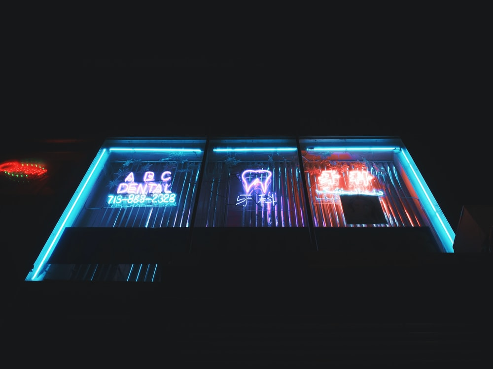 neon light signages during night time