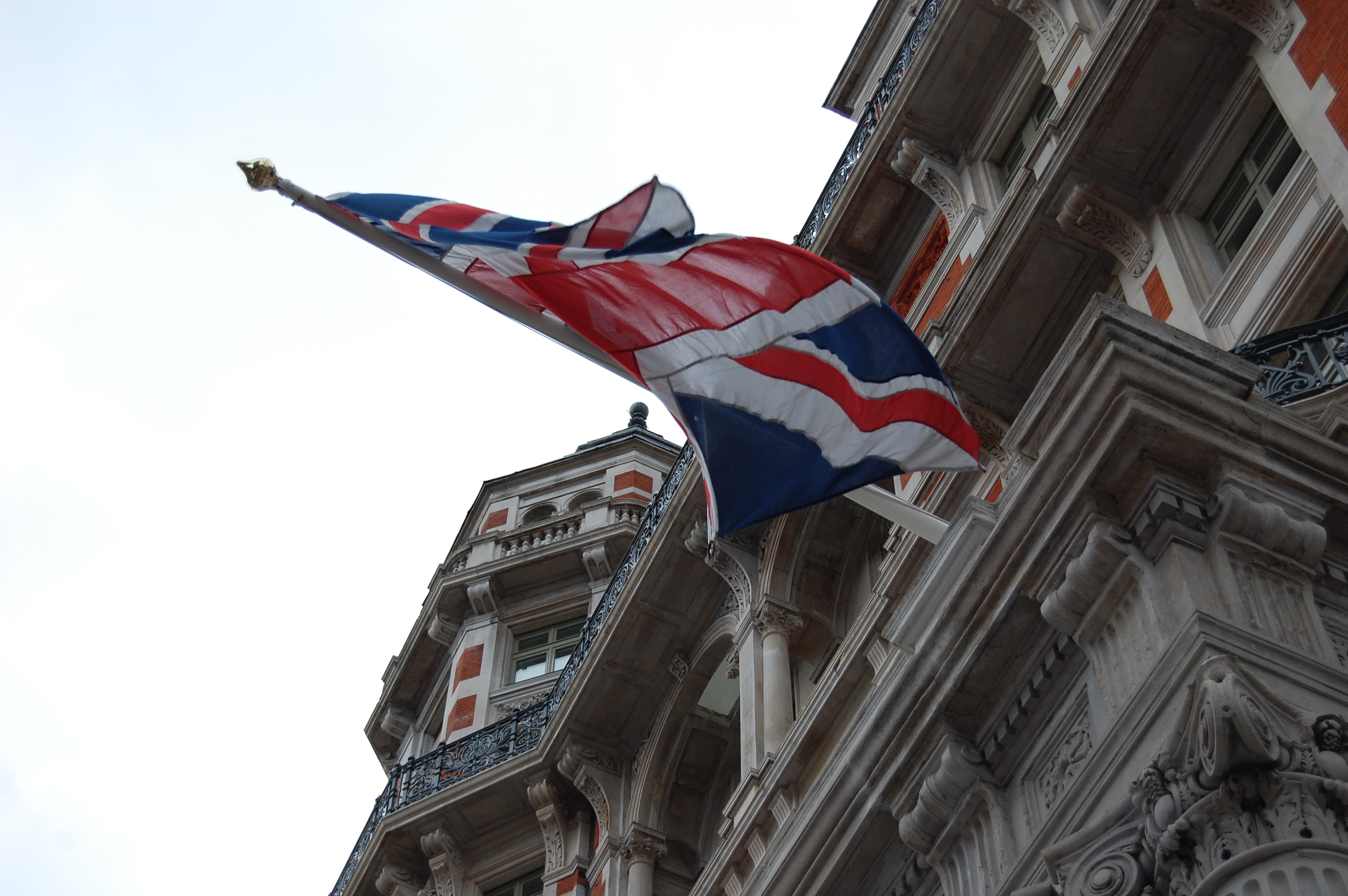 United Kingdom flag on white concrete building at daytime