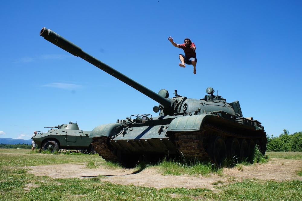 man jumping above Russian tank