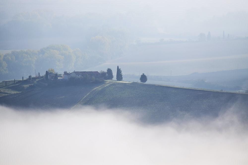 foggy mountain during daytime