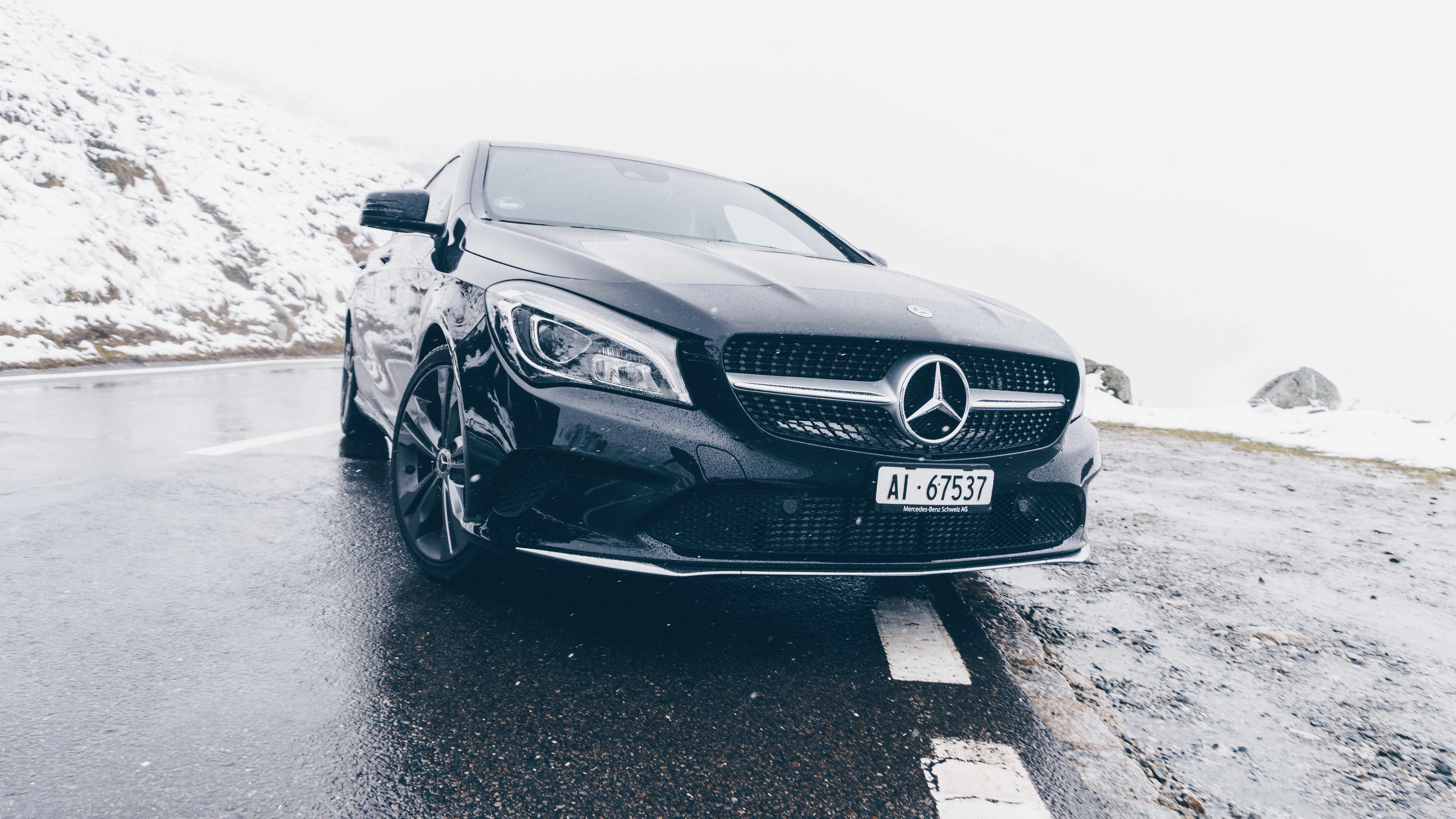 black Mercedes-Benz car on grey concrete surface