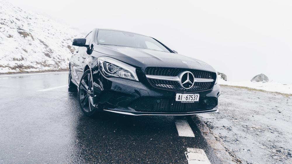 Black Mercedes Benz Car On Grey Concrete Surface